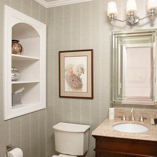 Стильный дизайн: маленький туалет в стиле современная классика с темными деревянными фасадами, плоскими фасадами, раздельным унитазом, бежевой плиткой, плиткой из листового камня, серыми стенами, врезной раковиной и столешницей из гранита - последний тренд