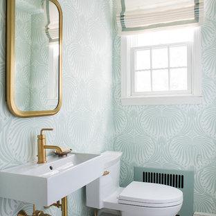 Immagine di un piccolo bagno di servizio classico con pareti blu, lavabo rettangolare, top in superficie solida, ante in stile shaker, ante bianche, WC sospeso, piastrelle bianche, piastrelle in pietra, pavimento con piastrelle a mosaico e pavimento bianco