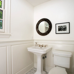 Example of a small classic gray tile and white tile marble floor powder room design in DC Metro with a two-piece toilet, white walls and a pedestal sink