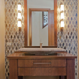 This is an example of a medium sized contemporary cloakroom in Tampa with freestanding cabinets, medium wood cabinets, multi-coloured tiles, mosaic tiles, a trough sink, wooden worktops and brown worktops.
