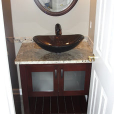 Traditional Powder Room by SIMMONS REMODELING