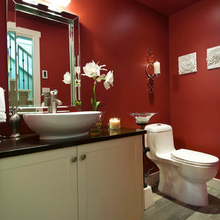 На фото: маленький туалет в классическом стиле с настольной раковиной, фасадами в стиле шейкер, столешницей из искусственного кварца, унитазом-моноблоком, разноцветной плиткой, красными стенами, полом из керамогранита и бежевыми фасадами с