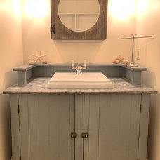 Beach Style Powder Room by MAC Custom Homes