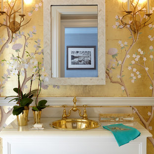 Inspiration for a medium sized bohemian cloakroom in New York with freestanding cabinets, a built-in sink, onyx worktops, white cabinets and yellow walls.