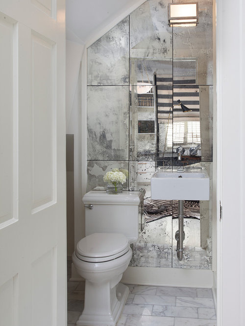 Inspiration For A Timeless Mirror Tile Powder Room Remodel In New Orleans With Wall
