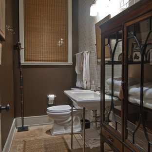 Small elegant white tile and subway tile ceramic tile and brown floor powder room photo in Houston with a two-piece toilet, brown walls and a wall-mount sink