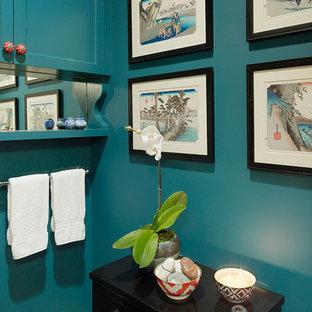 Ispirazione per un bagno di servizio etnico con pareti blu