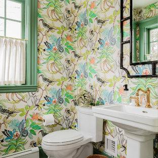На фото: туалеты в стиле современная классика с унитазом-моноблоком, разноцветными стенами, полом из мозаичной плитки, раковиной с пьедесталом и разноцветным полом