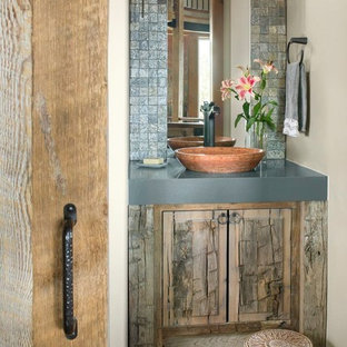 This is an example of a small rustic cloakroom in Denver with raised-panel cabinets, medium wood cabinets, slate tiles, beige walls, slate flooring, a vessel sink, engineered stone worktops, multi-coloured floors and grey worktops.
