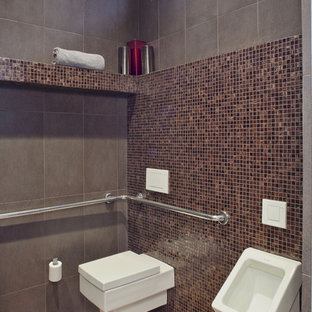 Inspiration for a contemporary cloakroom in Houston with an urinal, brown tiles and mosaic tiles.