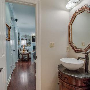 Esempio di un bagno di servizio chic di medie dimensioni con consolle stile comò, ante in legno bruno, pareti beige, pavimento in travertino, lavabo a bacinella, top in granito, pavimento beige e top grigio