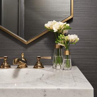 Идея дизайна: туалет среднего размера в современном стиле с унитазом-моноблоком, серыми стенами, полом из керамогранита, монолитной раковиной, мраморной столешницей, белым полом и белой столешницей