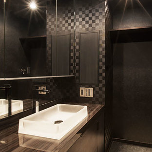 Inspiration for a medium sized contemporary cloakroom in Orange County with a built-in sink, beaded cabinets, dark wood cabinets, black tiles, black walls and slate flooring.