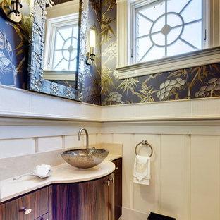 Immagine di un piccolo bagno di servizio classico con ante lisce, ante in legno bruno, pareti multicolore, pavimento in marmo, lavabo a bacinella, top in pietra calcarea e pavimento beige