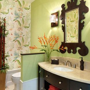 На фото: туалет среднего размера в морском стиле с плоскими фасадами, темными деревянными фасадами, врезной раковиной, серой плиткой, унитазом-моноблоком, зелеными стенами и бежевым полом с