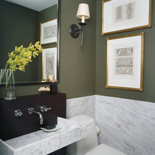 Powder room - contemporary marble tile powder room idea in Chicago with a wall-mount sink and green walls