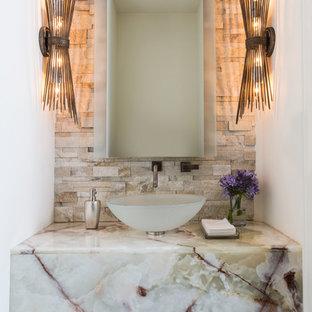 На фото: туалеты в современном стиле с бежевой плиткой, каменной плиткой, белыми стенами, темным паркетным полом, настольной раковиной, мраморной столешницей и белой столешницей