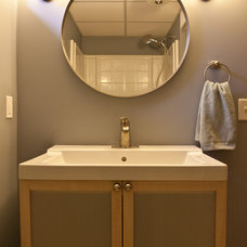 Contemporary Powder Room by White Crane Construction