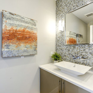 Contemporary cloakroom in Denver with flat-panel cabinets, beige cabinets, multi-coloured tiles, glass tiles, grey walls, light hardwood flooring and a vessel sink.