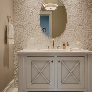 Powder room - mid-sized transitional porcelain tile ceramic tile powder room idea in Boston with beige walls, an undermount sink, solid surface countertops, gray cabinets, recessed-panel cabinets and white countertops