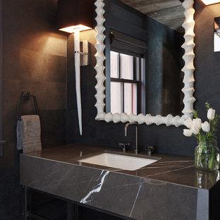 Imagen de aseo actual con lavabo bajoencimera, encimera de mármol y encimeras grises