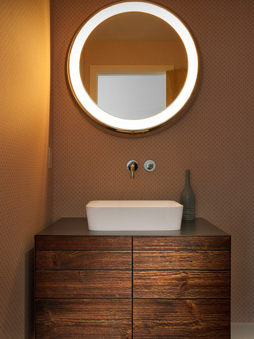 Inspiration for a mid-sized contemporary medium tone wood floor powder room  remodel in Denver