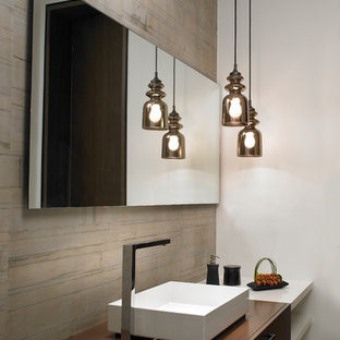 Inspiration for a mid-sized contemporary beige tile powder room remodel in Miami with dark wood cabinets and wood countertops