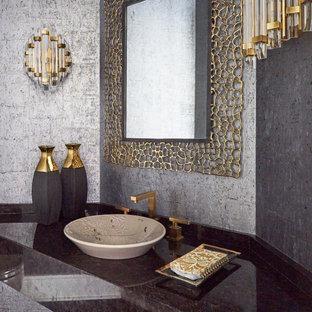 シカゴの中くらいのコンテンポラリースタイルのおしゃれなトイレ・洗面所 (グレーの壁、ベッセル式洗面器、ブラウンの洗面カウンター、フローティング洗面台、壁紙、茶色いキャビネット、御影石の洗面台) の写真