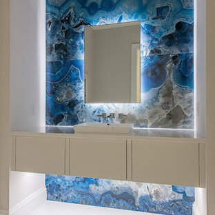 Inspiration for a contemporary cloakroom in Orange County with flat-panel cabinets, white cabinets, multi-coloured walls, a vessel sink and white floors.