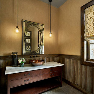 Large country cloakroom in Portland with freestanding cabinets, brown cabinets, beige walls, slate flooring, a vessel sink and marble worktops.
