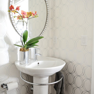 Inspiration for a small contemporary dark wood floor powder room remodel in Vancouver with a pedestal sink