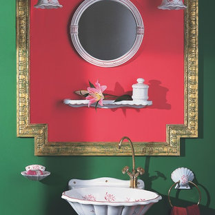 This is an example of a small world-inspired cloakroom in Miami with a wall-mounted sink and green walls.