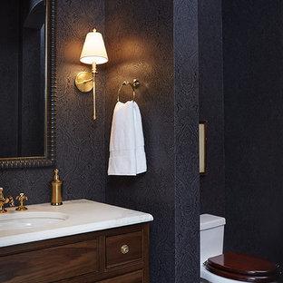 На фото: туалет среднего размера в классическом стиле с врезной раковиной, мраморной столешницей, унитазом-моноблоком, черными стенами и мраморным полом с