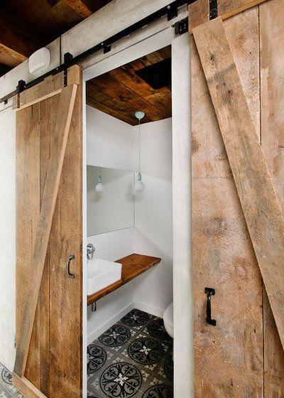 Industrial Powder Room by Atelier BOOM TOWN