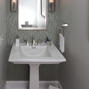 Photo of a small classic cloakroom in Raleigh with a two-piece toilet, grey walls, slate flooring, a pedestal sink, solid surface worktops and grey floors.