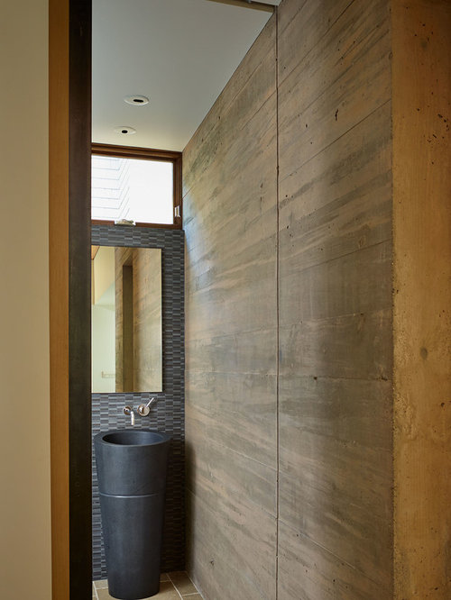 gray tile powder room idea in seattle with a pedestal sink