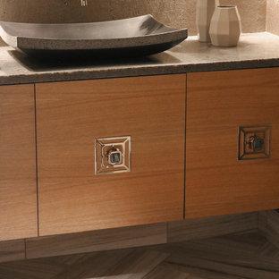 На фото: туалет среднего размера в стиле модернизм с плоскими фасадами с