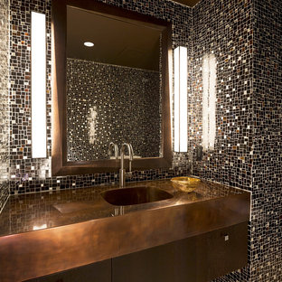 Inspiration for a contemporary cloakroom in Other with an integrated sink, flat-panel cabinets, dark wood cabinets, multi-coloured tiles, mosaic tiles and brown worktops.