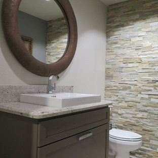Inspiration for a small contemporary cloakroom in Phoenix with shaker cabinets, brown cabinets, multi-coloured tiles, stone tiles, a vessel sink, grey walls and porcelain flooring.