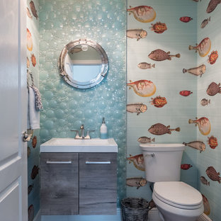 Photo of a nautical cloakroom in Miami with flat-panel cabinets, grey cabinets, multi-coloured tiles, glass tiles, multi-coloured walls, light hardwood flooring, engineered stone worktops and brown floors.