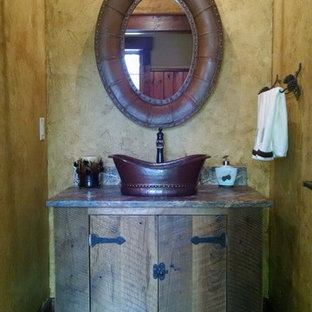 Design ideas for a small rustic cloakroom in Minneapolis with granite worktops and dark wood cabinets.