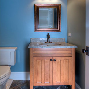 Photo of a small classic cloakroom in Chicago with recessed-panel cabinets, light wood cabinets, slate flooring and granite worktops.