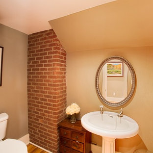 Example of an arts and crafts powder room design in Other