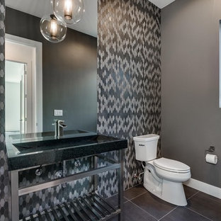 Photo of a medium sized contemporary cloakroom in Denver with multi-coloured tiles, stone tiles, grey walls, porcelain flooring, a trough sink and grey floors.