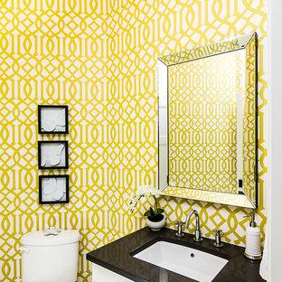 Пример оригинального дизайна интерьера: туалет в классическом стиле с врезной раковиной и белыми фасадами