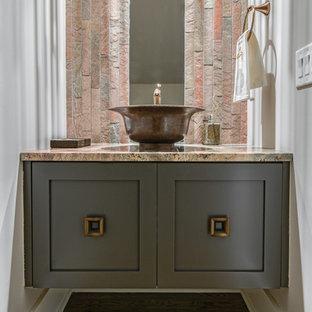 Foto di un piccolo bagno di servizio chic con ante con riquadro incassato, ante grigie, piastrelle in pietra, pareti grigie, pavimento in legno massello medio e top in granito