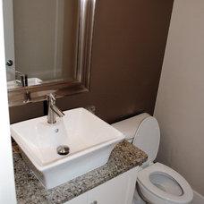 Traditional Powder Room by Cypress Homes, Inc.