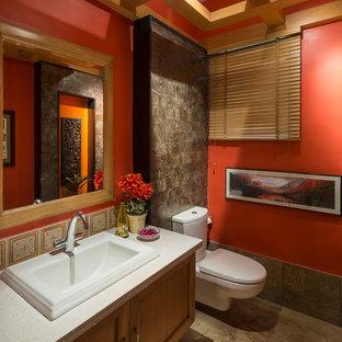 Diseño de aseo de estilo zen, pequeño, con sanitario de dos piezas, paredes rojas, suelo de mármol, lavabo encastrado, encimera de granito, suelo marrón, armarios con paneles empotrados y puertas de armario de madera oscura
