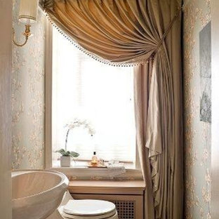 This is an example of a small traditional cloakroom in Other with freestanding cabinets, beige cabinets, a one-piece toilet, multi-coloured walls, slate flooring, a pedestal sink, solid surface worktops, grey floors and white worktops.