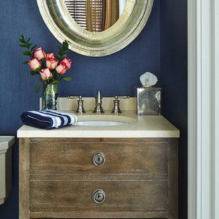 マイアミの小さいラスティックスタイルのおしゃれなトイレ・洗面所 (アンダーカウンター洗面器、フラットパネル扉のキャビネット、ヴィンテージ仕上げキャビネット、大理石の洗面台、一体型トイレ、青い壁、磁器タイルの床) の写真
